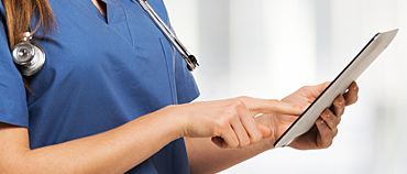 Nurse enters patient information on tablet
