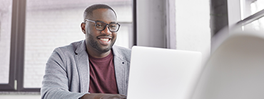 African American man reviewing Healthcare information on myAvatar